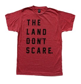 'The Land Don't Scare' in Black on Heather Red Unisex Tee