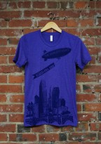 'World Is Yours' on Purple Tri-Blend Unisex Tee