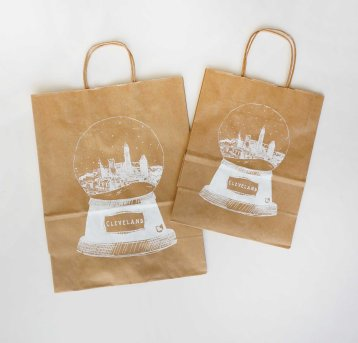 'Cleveland Snow Globe' in White on Kraft Paper Gift Bags