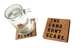 'The Land Don't Scare' in Black on Cork Coaster (Installed)