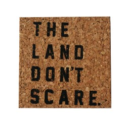 'The Land Don't Scare' in Black on Cork Coaster