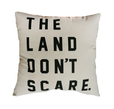 'The Land Don't Scare' in Black on Natural Canvas Pillow