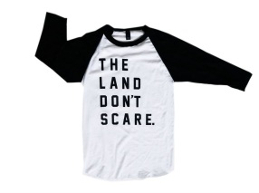 'The Land Don't Scare' in Black on White and Black Raglan Tee