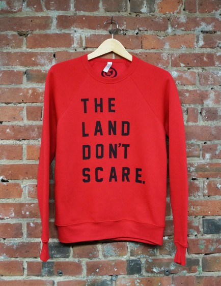 'Land Don't Scare' on Red Crew Sweatshirt